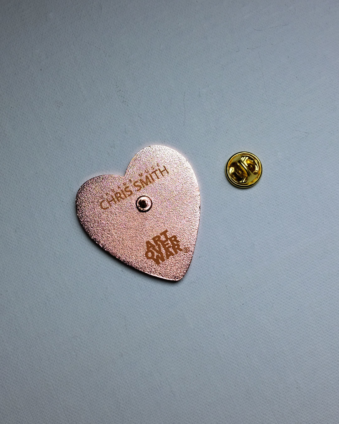 ART OVER WAR® Heart Logo Pin