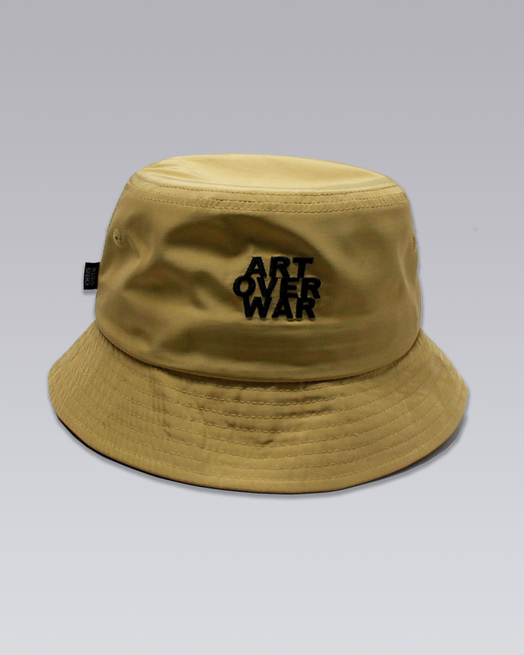 photo-1b-URBANE-MUSE-CHRIS-SMITH-Tan-AOW-nylon-bucket-hat-d